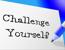 Picture of a pen and Post-It Note with the words 'challenge yourself' written on